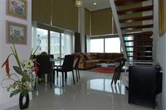 Condominium for sale Naklua showing the dining and living areas