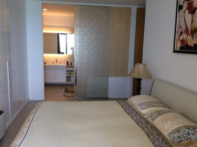 Condominium For Sale Northpoint Pattaya showing the master bedroom with en-suite