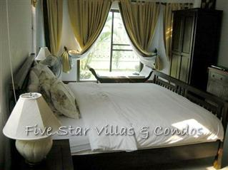House for Sale Baan Amphur beach Pattaya showing the master bedroom