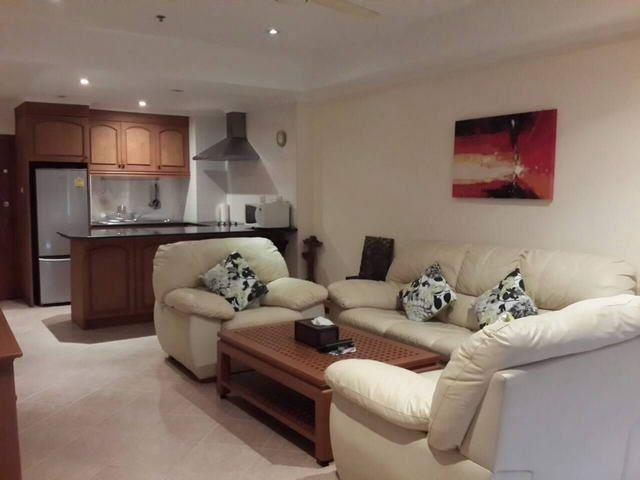 Condominium for sale Jomtien showing the living room and kitchen