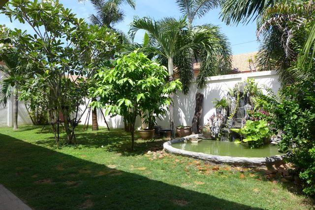 House For Sale East Pattaya showing the Fish Pond with Rockery and Waterfall