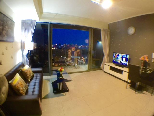 Condominium for sale at Zire Pattaya showing the living room and balcony view