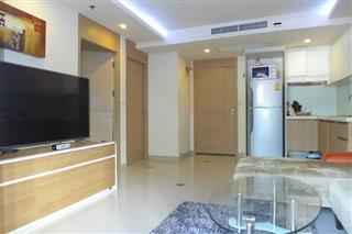 Condominium for sale Pattaya showing the living room and kitchen