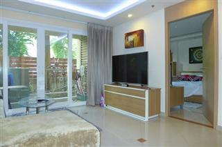 Condominium for sale Pattaya showing the living area and balcony