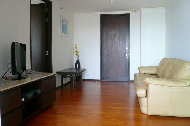 Condominium for sale in Pattaya showing the sitting area and TV