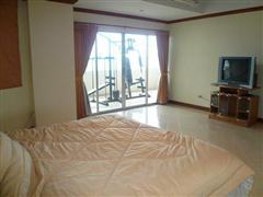 Condominium for sale in Na Jomtien showing the bedroom and TV