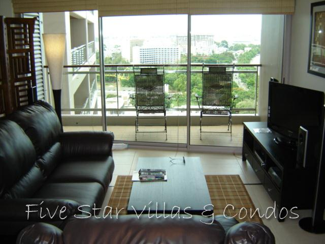 Condominium for sale in Pattaya at Northshore showing the sitting area and balcony looking down the Bay