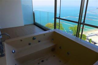 Condominium for sale Wong Amat showing the balcony jacuzzi tub