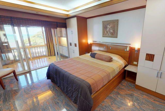 Condominium for sale Ban Amphur showing the master bedroom suite