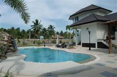House for sale Na Jomtien showing pool and house