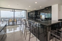 Condominium for sale Pratumnak Pattaya showing the dining, kitchen and balcony