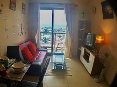 Condominium for sale UNIXX South Pattaya showing the living room and balcony