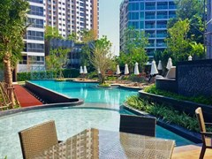 Condominium for sale UNIXX South Pattaya showing the communal swimming pool and terraces