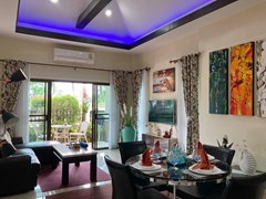 House for sale Pattaya showing the dining, living areas and terrace