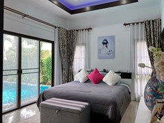 House for sale Pattaya showing the master bedroom pool view