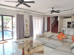 House for sale at Bangsaray Pattaya showing the living area poolside
