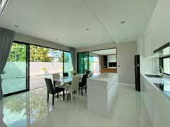 House for sale East Pattaya showing the kitchen, dining and living areas