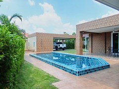 House for sale Huay Yai Pattaya showing the house, pool and carport