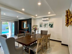 House for sale Jomtien showing the dining area with pool view