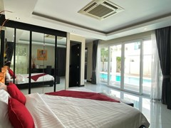 House for sale Jomtien showing the master bedroom poolside