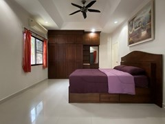 House for sale Jomtien showing the second bedroom with built-in wardrobes