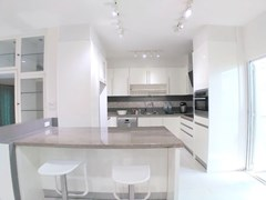 House for sale Mabprachan Pattaya showing the kitchen and breakfast bar