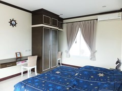 House for sale Na Jomtien Pattaya showing the second bedroom and built-in wardrobes