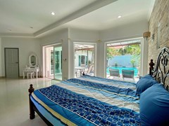 House for sale Pratumnak Pattaya showing the second master bedroom with pool view