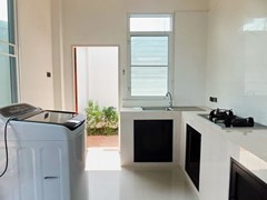 House for sale WongAmat Pattaya showing the kitchen and outside utilities area
