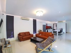House for sale Mabprachan Pattaya showing the living, dining and kitchen areas