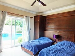 House for sale Nongpalai Pattaya showing the guest bedroom pool view