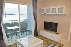 Condominium for rent Pratumnak Pattaya showing the living area and balcony view