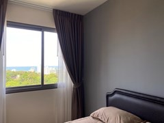 Condominium for rent UNIXX South Pattaya showing the bedroom with sea view