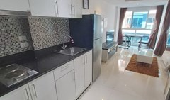 Condominium for rent Pattaya showing the kitchen, living and dining areas