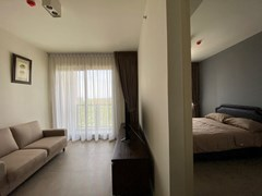Condominium for rent UNIXX South Pattaya showing the living area and bedroom