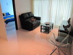 Condominium for rent Pattaya showing the living room and bedroom