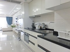 Condominium for sale Jomtien showing the kitchen, dining and living areas