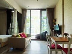 Condominium for sale Wong Amat Pattaya showing the living, dining and balcony