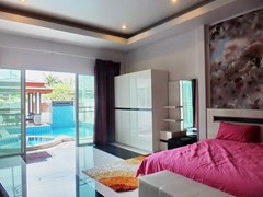 House for rent Huay Yai Pattaya showing the master bedroom poolside