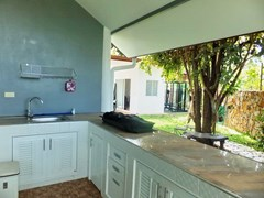 room House for sale Huay Yai Pattaya showing the Thai kitchen and gymnasium