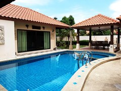 House for sale Huai Yai Pattaya showing the pool and garden