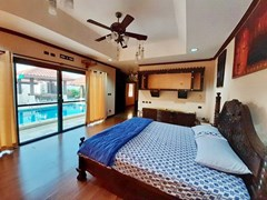 House for sale Huai Yai Pattaya showing the master bedroom with pool view