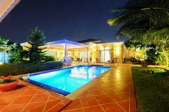 House for sale Siam Royal View Pattaya showing the pool and house at night