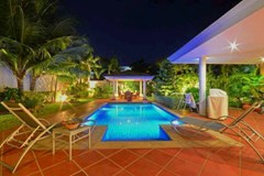 House for sale Siam Royal View Pattaya showing the pool and terraces at night