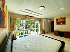House for sale East Pattaya showing the master bedroom with pool view