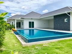 House for sale East Pattaya showing the house, pool and covered terraces