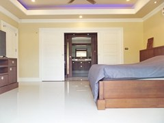 House for sale Nongpalai Pattaya showing the master bedroom with walk-in wardrobes