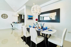 House for sale Pattaya showing the dining and kitchen areas