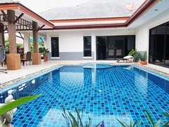 House for Sale Pattaya showing the house, terrace and pool