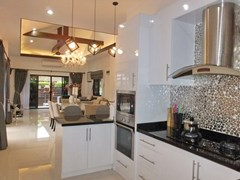 House for Sale Pattaya showing the kitchen, dining and living areas